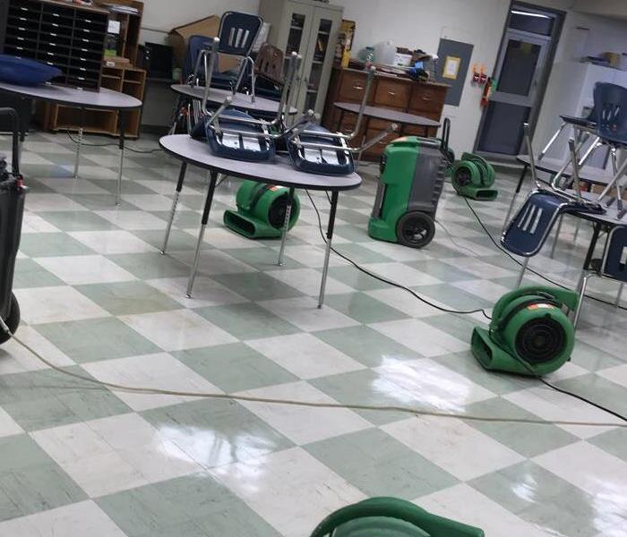 Conference Room Flooded With SERVPRO Equipment In Action To Dry The Tile Flooring