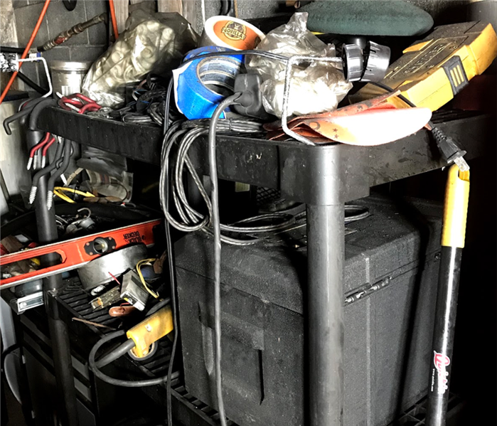 Sorted And Salvaged Equipment And Tools From House Sitting In Basement Fire.