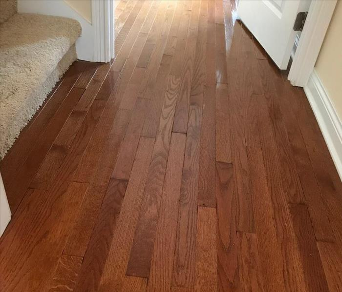 Hardwood flooring that has been restored and shined in home.