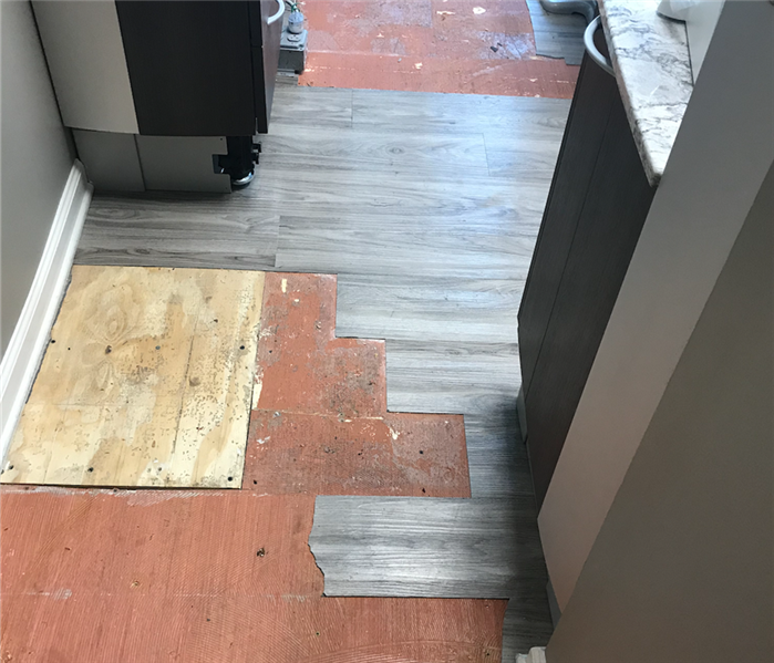Vinyl flooring that faced water damage and has missing sections that were wet.